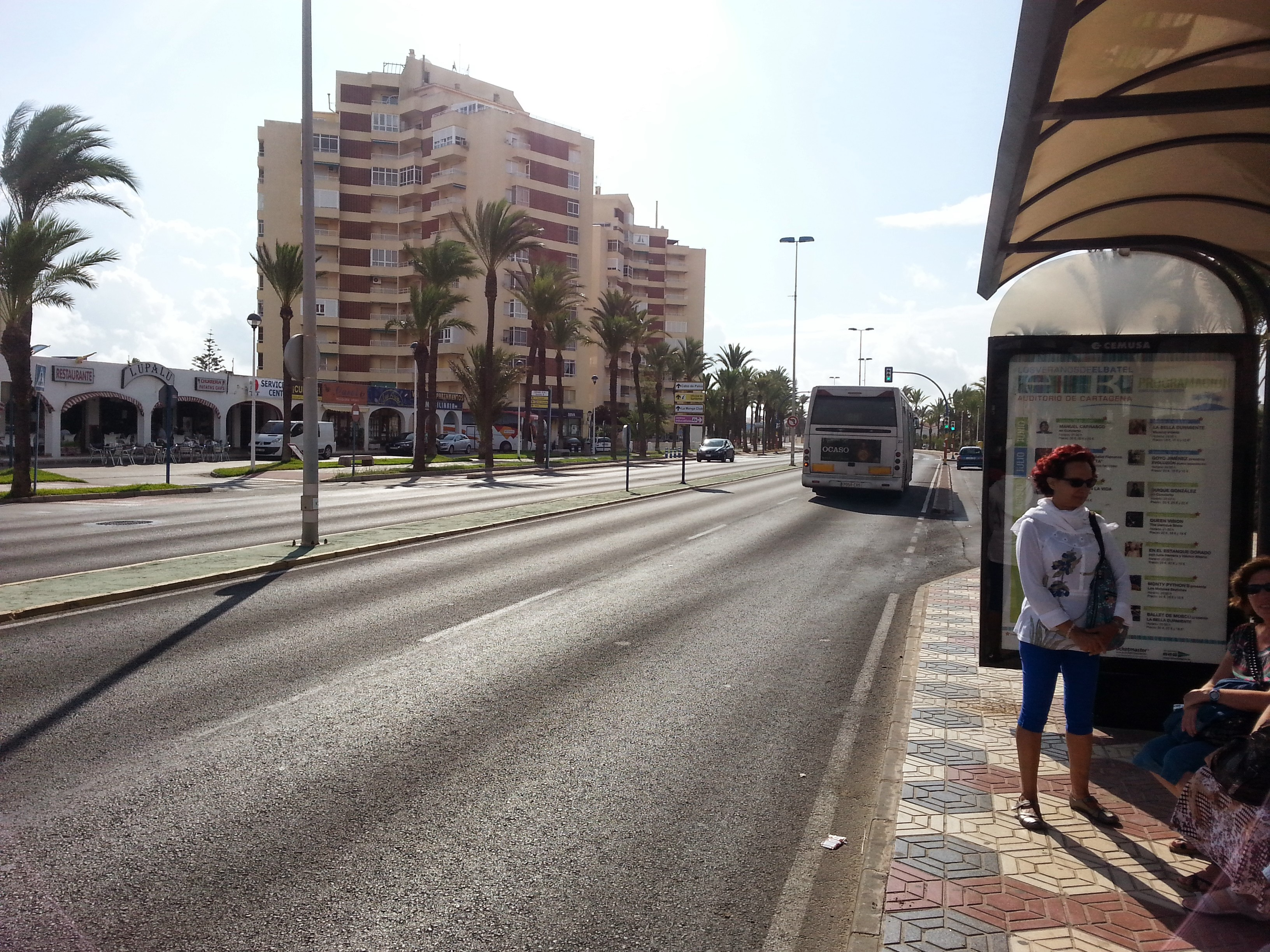 A bus drives down La Manga strip