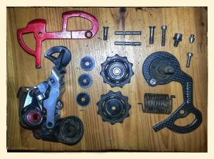 The parts that make up a derailleur laid out